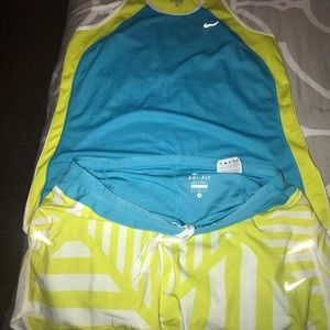 Blue and lime/yellow Nike tennis, athletic wear.